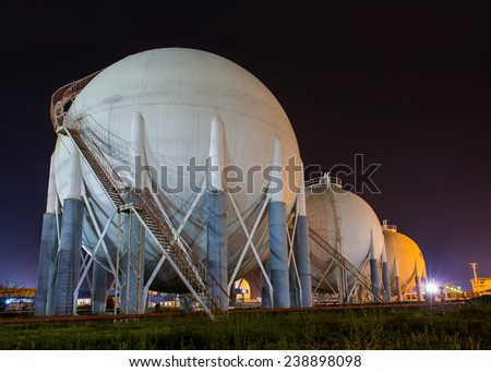 large white tanks for petrol and oil in the harbor - stock photo