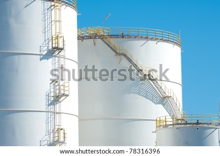 large white tanks for petrol and oil in the Rotterdam harbor - stock photo