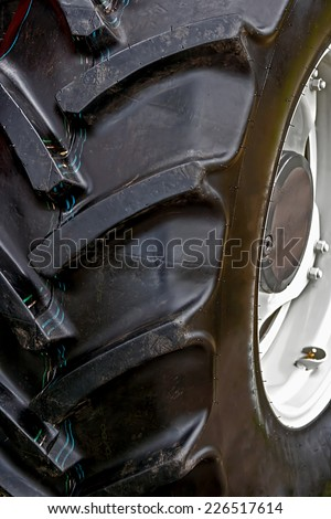 Large white wheel rim, for machinery used in agriculture. Detail - stock photo