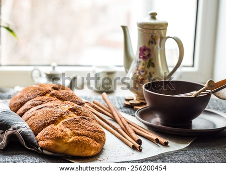 large wicker buns with cinnamon and golden brown, sweet pastries - stock photo