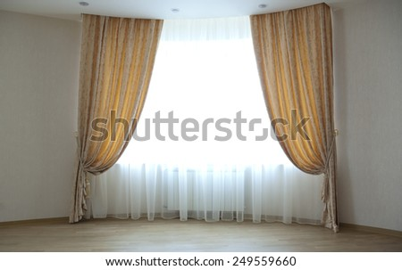 Large window with classical curtains - stock photo