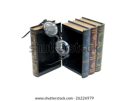 Large wooden block hollowed and carved to resemble a book with black horn rimmed glasses hanging from the edge - path orig size