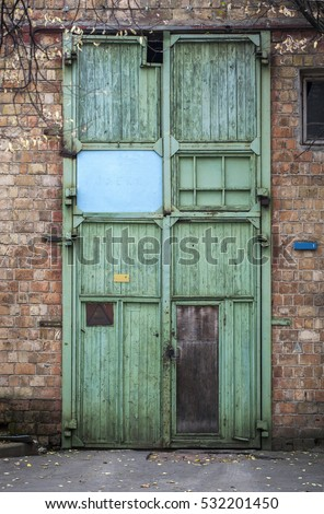 Large Wooden Doors Of The Warehouse. Abandoned Warehouse