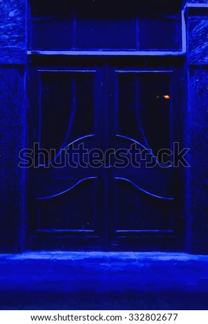 Large wooden double-door brightly lit by a blue light at night
