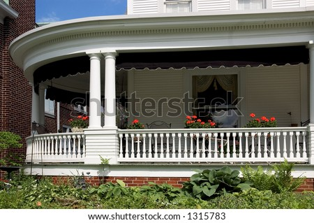 Large wrap around front porch with lots of detail work in the moldings and trim.