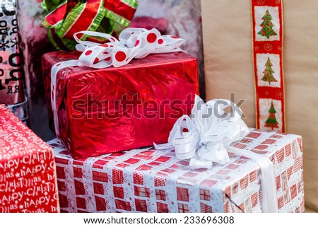 Large wrapped Christmas presents under the tree.