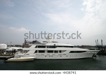 large yacht with helicopter pad - stock photo