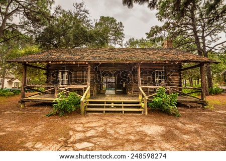 "LARGO, FLORIDA - JANUARY 14, 2015 : McMullen-Coachman Log House in the Pinellas County Heritage Village. It is a typical Florida ""Cracker"" log home of the pioneer period."