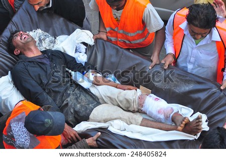 LARKANA, PAKISTAN - JAN 30: Injured of suicidal bomb blast which occurred onto a mosque of Shikarpur during Friday prayer, are being shifting to Hospital on January 30, 2015 in Larkana.