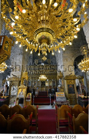 LARNACA, CYPRUS, April 11, 2016: Golden chandelier with many lights in interior of the St. Lazarus church located in the center of the old town of Larnaca city on Cyprus island.