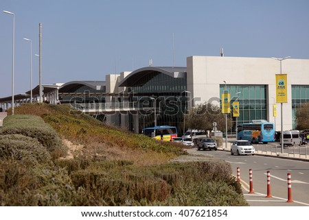 LARNACA, CYPRUS - MARCH 18, 2016: People and cars at the building of Larnaca International Airport. It is Cyprus' main international gateway and the larger of the country's two commercial airports - stock photo
