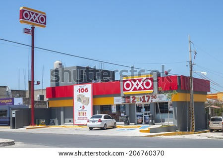 LAS CHOAPAS, MEXICO - JULY 19, 2014: The OXXO franchise of convenience stores is the largest of its kind in Mexico and has over 11,000 stores in Latin America. - stock photo