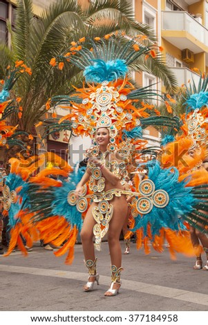"LAS PALMAS - February 13: Music and dancer groups in colorful costumes take part in the Las Canteras beach carnival parade ""Carnaval al Sol"", February 13, 2016 in Las Palmas, Gran Canaria, Spain"