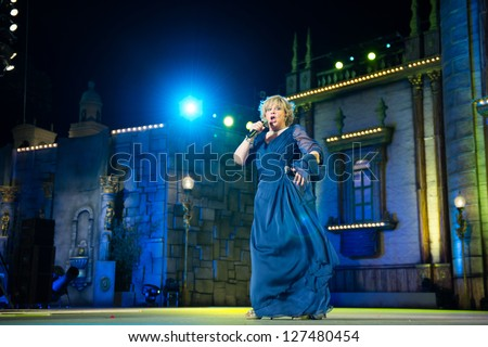 LAS PALMAS - FEBRUARY 3: Singer Karina from Andalusia, who took part in Eurovision Song Contest in 1966, performing onstage during Gala of the Great Lady contest February 3, 2013 in Las Palmas, Spain. - stock photo