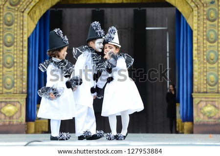 LAS PALMAS , SPAIN -FEBRUARY 10: Paula Alamo (l), Karla Garcia (r) and unidentified boy (m) from Canary Islands, perform during Children's Costume and Murgas, on February 10, 2013 in Las Palmas, Spain - stock photo