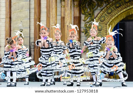 LAS PALMAS, SPAIN - FEBRUARY 10: Unidentified children from dance group Chiara's Gilr, from Canary Islands, performing during Children's Costume and Murgas, on February 10, 2013 in Las Palmas,Spain - stock photo