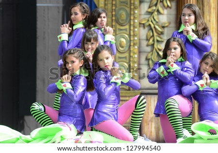 LAS PALMAS, SPAIN - FEBRUARY 10: Unidentified children from dance group Janette Dorta, from Canary Islands, performing during Children's Costume and Murgas, on February 10, 2013 in Las Palmas, Spain - stock photo