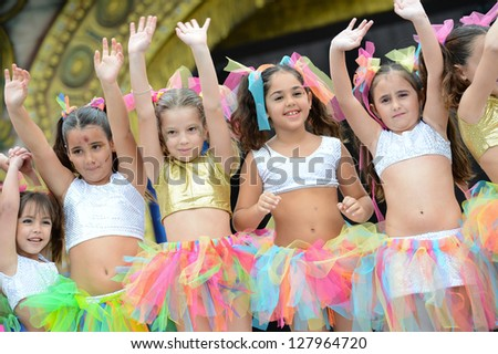 LAS PALMAS, SPAIN - FEBRUARY 10: Unidentified children from dance group Suleica Borges, from Canary Islands, performing during Children's Costume and Murgas, on February 10, 2013 in Las Palmas,Spain - stock photo