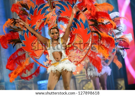 LAS PALMAS , SPAIN - FEBRUARY 8: Unidentified member from dance group Brisa De Volcan, from Canary Islands, during the Adult Comparsas Contest on February 8, 2013 in Las Palmas, Spain