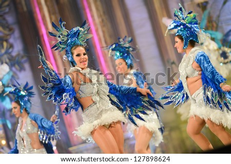 LAS PALMAS , SPAIN - FEBRUARY 8: Unidentified members from dance group Brisa De Volcan, from Canary Islands, during the Adult Comparsas Contest on February 8, 2013 in Las Palmas, Spain - stock photo