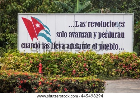 LAS TUNAS, CUBA - JAN 27, 2016: Propaganda billboard at Plaza de la Revolucion (Square of the Revolution). It says: The revolutions only advance and persist when they are carried by the peoples.