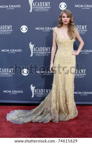 LAS VEGAS - APR 3:  Taylor Swift arrives at the Academy of Country Music Awards 2011 at MGM Grand Garden Arena on April 3, 2010 in Las Vegas, NV. - stock photo