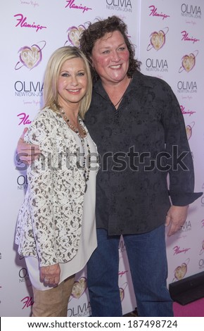 LAS VEGAS, - APRIL 11: Entertainer Olivia Newton-John (L) and actress Dot Jones attends the grand opening of her residency show 'Summer Nights' at Flamingo Las Vegas on April 11, 2014 - stock photo