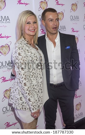 LAS VEGAS, - APRIL 11: Entertainer Olivia Newton-John (L) and actress Joey Lawrence attends the grand opening of her residency show 'Summer Nights' at Flamingo Las Vegas on April 11, 2014 - stock photo