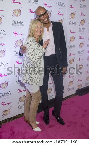 LAS VEGAS - APRIL 11: Entertainer Olivia Newton-John (L) and television personality RuPaul attend the grand opening of her residency show 'Summer Nights' at Flamingo Las Vegas on April 11, 2014  - stock photo