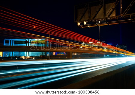 LAS VEGAS - APRIL 12: In this time lapse image, with the Las Vegas Strip in the background, traffic travels along Interstate 15 on April 12, 2012.  The strip is approximately 4.2 mi (6.8 km) long. - stock photo