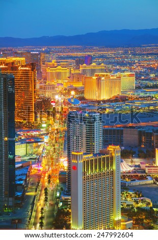 LAS VEGAS - April 20: Overview of downtown Las Vegas in the night on April 20, 2014 in Las Vegas. It's the most populous city in the state of Nevada and the county seat of Clark County. - stock photo