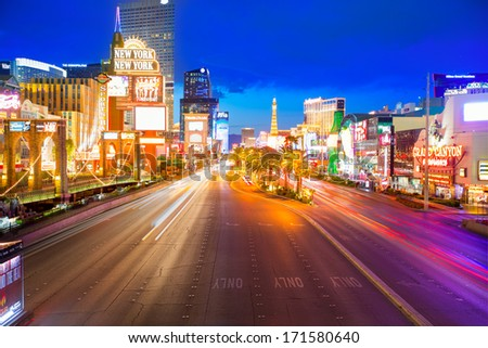 LAS VEGAS - APRIL 17, 2013: Sunset view of the famous Strip from high angle with night lights in Las Vegas, Nevada, April 17, 2013 - stock photo