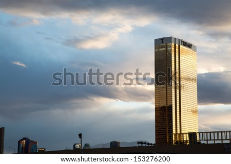 Las Vegas - April 17: The Trump hotel Las Vegas, at dusk. This 64 story hotel-condominium has exterior windows coated in 24 carat gold. On April 17 2013 in Las Vegas USA - stock photo