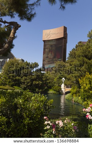 LAS VEGAS - APRIL 27, 2013 - The Wynn Sign on April 27, 2013  in Las Vegas. The Metal portion of the sign moves from top to bottom every few minutes, revealing new scenes and ads. - stock photo