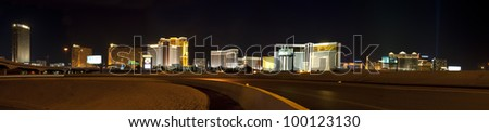 LAS VEGAS - APRIL 11: This long exposure on April 11, 2012, shows traffic along the Interstate 15 through Las Vegas with The Strip in the background. The Strip is approximately 4.2 mi (6.8 km) long. - stock photo