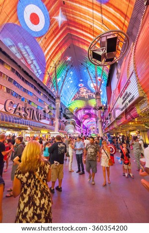LAS VEGAS - AUG 11 : The Fremont Street Experience an attraction in downtown Las Vegas on August 11, 2014. Las Vegas in 2014 broke the all-time visitor volume record of 39-plus million visitors - stock photo