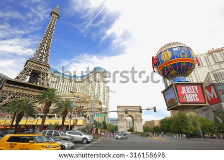 LAS VEGAS - AUGUST 7: Image of the strip at Las Vegas which is the famous main road where tourists walk amoung casinos, hotels and  upscale shops August 7, 2015 in Las Vegas NV - stock photo