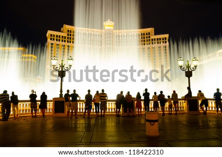 LAS VEGAS - AUGUST 12: Musical fountains at Bellagio Hotel & Casino on August 12, 2012 in Las Vegas. The Bellagio opened October 15, 1998, it was the most expensive hotel ever built at US$1.6 bn. - stock photo