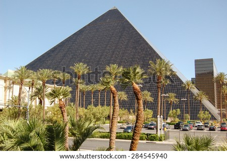 LAS VEGAS - CIRCA MAY 2012: Luxor Hotel and Casino in Las Vegas, NV. Built in 1993, the theme hotel was modeled after an Egyptian pyramid with a replica of the Sphinx at its entrance. - stock photo