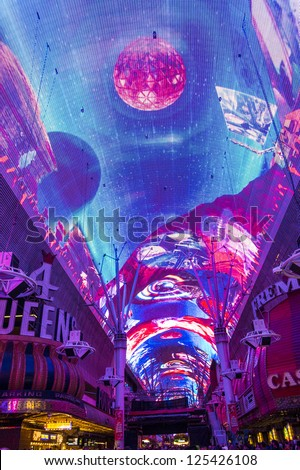 LAS VEGAS - DEC 07 : The Fremont Street Experience an attraction in downtown Las Vegas on December 07, 2012. Las Vegas in 2012 broke the all-time visitor volume record of 39-plus million visitors - stock photo