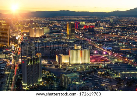 LAS VEGAS - DECEMBER 8, 2013: aerial view of the west side of the Strip at sunset. The Las Vegas Strip is boasting the latest in new-urban architecture, design and technology. - stock photo