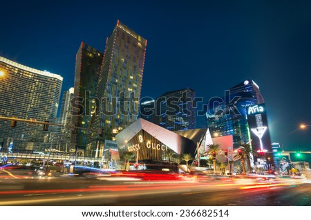 LAS VEGAS - DECEMBER 7, 2013: blurred lights on the Strip at sunset. Aria Resort and Casino is a luxury accommodation building, part of City Center complex on the Las Vegas Boulevard in Nevada Usa  - stock photo