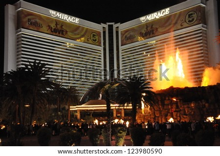 "LAS VEGAS - DECEMBER 5: Mirage Hotel and Casino on December 5, 2012 on the Strip in Las Vegas, Nevada. An artificial volcano along the Strip that ""erupts"" nightly from 8 pm Â?Â?midnight on the hour. - stock photo"
