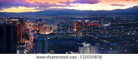 LAS VEGAS -DECEMBER 27: Vegas Strip on DECEMBER 27, 2012 in Las Vegas, Nevada. Most of the Strip designated as one of All American  roads because of its unique distinction during nighttime. - stock photo
