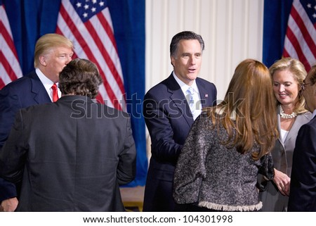 LAS VEGAS - FEB 2: Mitt and Ann Romney speak with an unidentified person at the Trump hotel on February 2, 2012 in Las Vegas, Nevada. Donald Trump has endorsed Romney for president. - stock photo