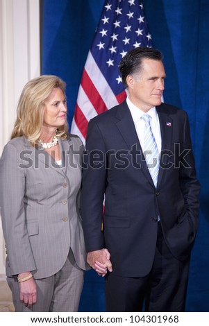 LAS VEGAS - FEB 2: Mitt Romney and his wife, Ann Romney, listen as Donald Trump (off camera) endorses him for president at the Trump Hotel on February 2, 2012 in Las Vegas, Nevada. - stock photo