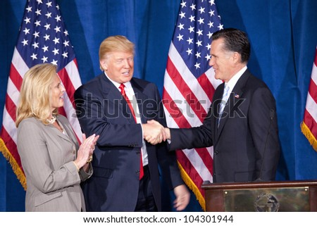 LAS VEGAS - FEB 2: Mitt Romney (C) shakes hands with Donald Trump as Romney's wife, Ann Romney, watches at the Trump Hotel on February 2, 2012 in Las Vegas, Nevada. Trump is endorsing Romney for president. - stock photo