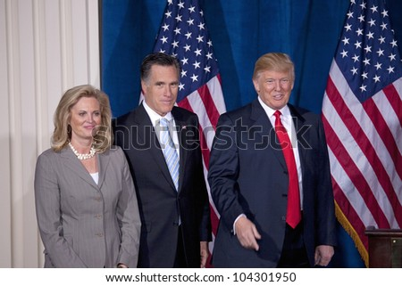 LAS VEGAS - FEB 2: Mitt Romney (C) stands with his wife, Ann Romney, and Donald Trump at Trump's hotel on February 2, 2012 in Las Vegas, Nevada. Trump is endorsing Romney for president. - stock photo