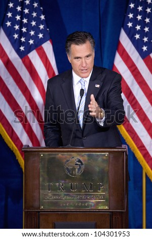 LAS VEGAS - FEB 2: Mitt Romney gestures as he speaks at the Trump hotel on February 2, 2012 in Las Vegas, Nevada. Donald Trump is endorsing Romney for president.