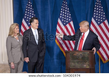 LAS VEGAS - FEB 2: Mitt Romney (2nd-L) and his wife, Ann, listen as Donald Trump (C) endorses him for president at the Trump Hotel on February 2, 2012 in Las Vegas, Nevada. - stock photo
